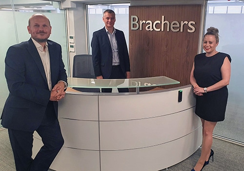 Partners Lee May, James Bullock and Alexandra Gordon in the reception of Brachers' Canterbury office
